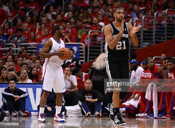 Tim Duncan of the San Antonio Spurs reacts alongside Chris Paul of the Los Angeles Clippers in the first quarter in Game Four of the Western...