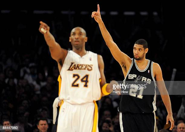 Tim Duncan of the San Antonio Spurs reacts to a foul next to Kobe Bryant of the Los Angeles Lakers during the forth quarter at the Staples Center on...