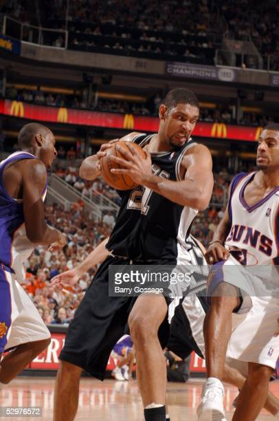 Tim Duncan of the San Antonio Spurs rebounds against the Phoenix Suns in Game two of the Western Conference Finals during the 2005 NBA Playoffs at...