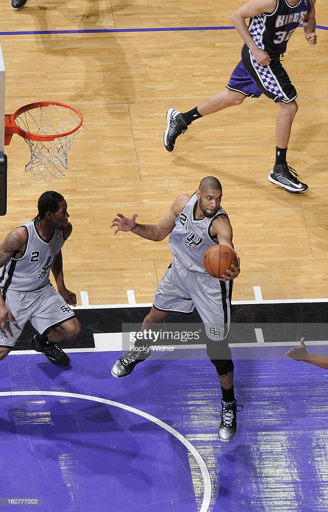 Tim Duncan #21 of the San Antonio Spurs rebounds against the Sacramento Kings on February 19, 2013 at Sleep Train Arena in Sacramento, California.