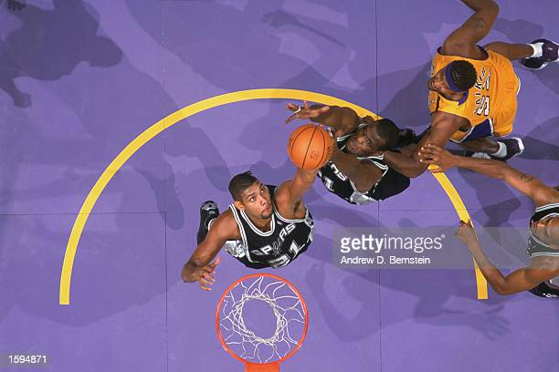 Tim Duncan of the San Antonio Spurs rebounds over teammate Malik Rose during the NBA game against the Los Angeles Lakers at Staples Center on October...