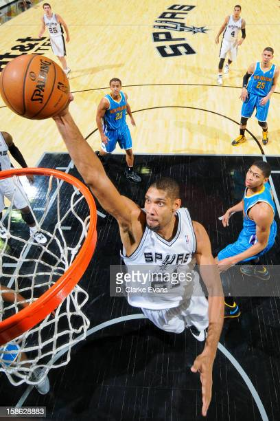 Tim Duncan of the San Antonio Spurs rises for a dunk against the New Orleans Hornets on December 21 2012 at the ATT Center in San Antonio Texas NOTE...