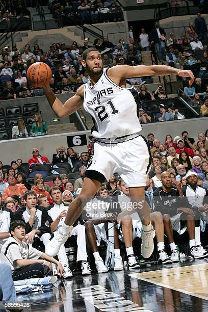 Tim Duncan of the San Antonio Spurs saves the ball from going out of bounds against the Memphis Grizzlies during the game at the ATT Center on...