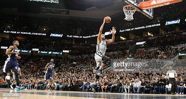 Tim Duncan of the San Antonio Spurs scores against the Memphis Grizzlies in Game One of the Western Conference Quarterfinals during the 2016 NBA...