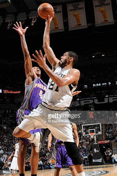 Tim Duncan of the San Antonio Spurs shoots against Channing Frye of the Phoenix Suns in Game Four of the Western Conference Semifinals during the...