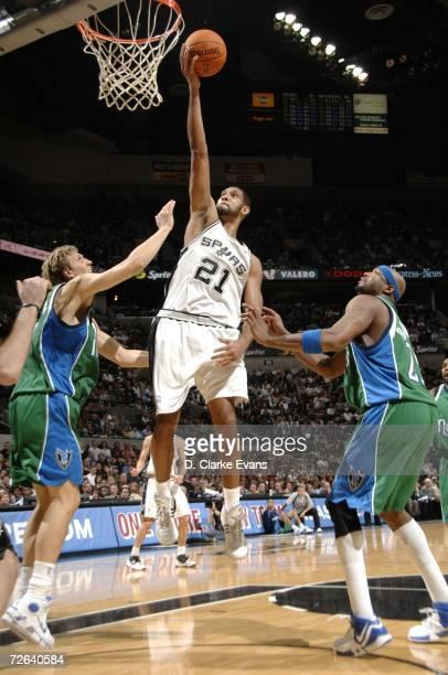 Tim Duncan of the San Antonio Spurs shoots against Dirk Nowitzki of the Dallas Mavericks at the ATT Center on November 24 2006 in San Antonio Texas...