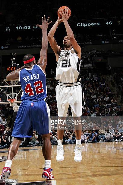 Tim Duncan of the San Antonio Spurs shoots against Elton Brand of the Los Angeles Clippers during the game at the ATT Center on March 13 2007 in San...