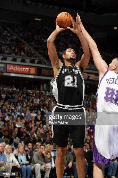 Tim Duncan of the San Antonio Spurs shoots against Greg Ostertag of the Sacramento Kings on January 23 2005 at Arco Arena in Sacramento California...