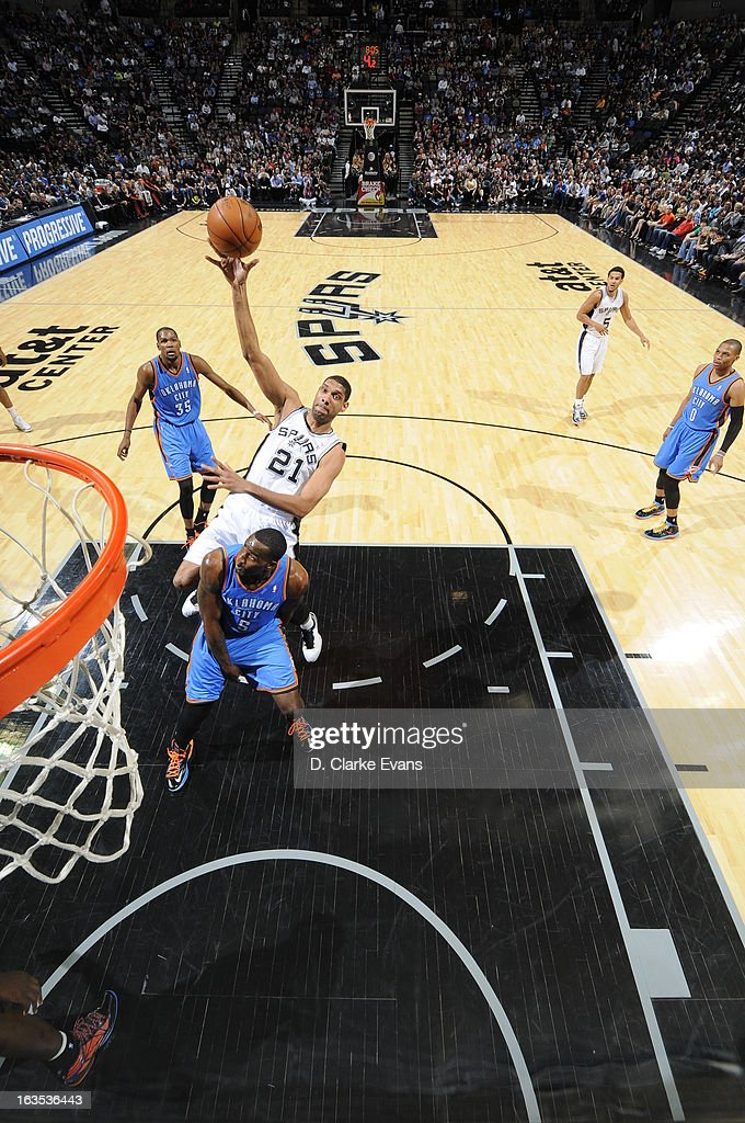 Tim Duncan #21 of the San Antonio Spurs shoots against Kendrick Perkins #5 of the Oklahoma City Thunder on March 11, 2013 at the AT&T Center in San Antonio, Texas.