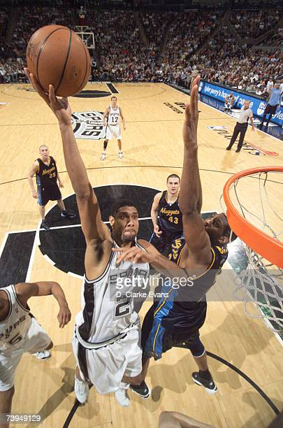 Tim Duncan of the San Antonio Spurs shoots against Nene of the Denver Nuggets in Game One of the Western Conference Quarterfinals during the 2007 NBA...