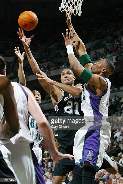Tim Duncan of the San Antonio Spurs shoots against the Milwaukee Bucks during the game at Bradley Center on March 11 2003 in Milwaukee Wisconsin The...