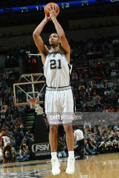 Tim Duncan of the San Antonio Spurs shoots during the game against the Los Angeles Clippers on January 19 2005 at the SBC Center in San Antonio Texas...