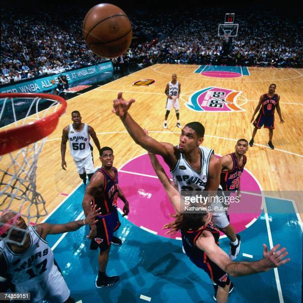 Tim Duncan of the San Antonio Spurs shoots over Chris Dudly of the New York Knicks during Game One of the 1999 NBA Finals played on June 16 1999 at...