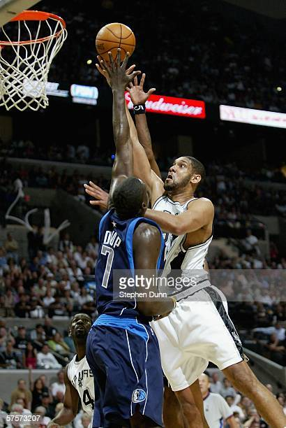 Tim Duncan of the San Antonio Spurs shoots over DeSagana Diop of the Dallas Mavericks in game two of the Western Conference Semifinals during the...