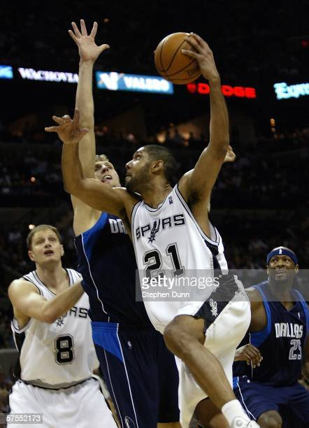 Tim Duncan of the San Antonio Spurs shoots over Dirk Nowitzki of the Dallas Mavericks in game one of the Western Conference Semifinals during the...