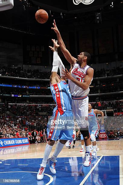 Tim Duncan of the San Antonio Spurs shoots over Kenyon Martin of the Los Angeles Clippers at Staples Center on February 18 2012 in Los Angeles...