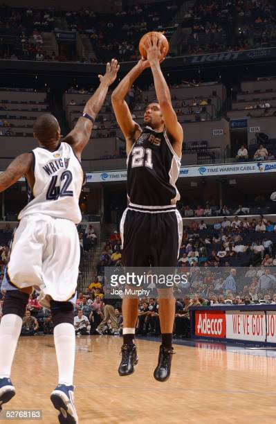 Tim Duncan of the San Antonio Spurs shoots over Lorenzen Wright of the Memphis Grizzlies during the game at FedExForum on April 18 2005 in Memphis...