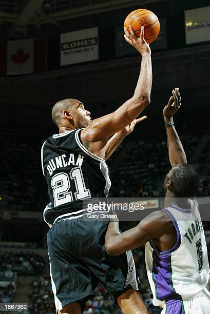 Tim Duncan of the San Antonio Spurs shoots over Tim Thomas of the Milwaukee Bucks during the game at Bradley Center on March 11 2003 in Milwaukee...