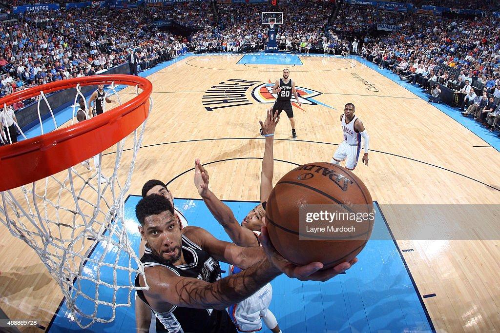 Tim Duncan #21 of the San Antonio Spurs shoots the ball against the Oklahoma City Thunder on April 7, 2015 at Chesapeake Energy Arena in Oklahoma City, Oklahoma.