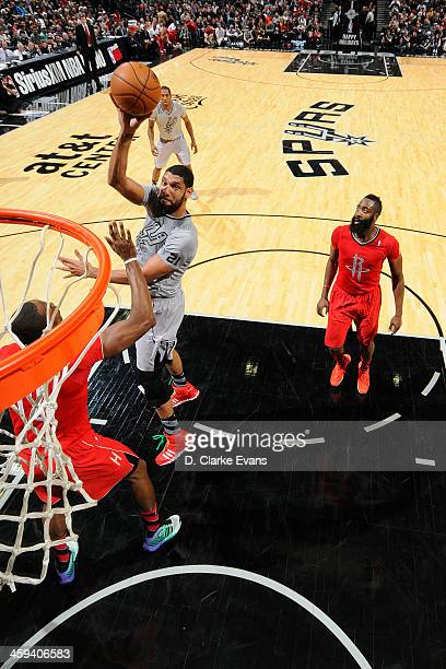 Tim Duncan of the San Antonio Spurs shoots the ball against the Houston Rockets during the game at the ATT Center on December 25 2013 in San Antonio...