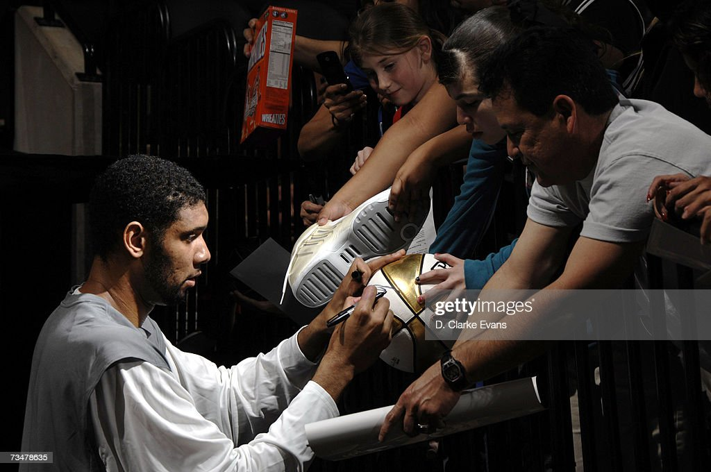 Tim Duncan of the San Antonio Spurs signs autographs before a game against the Orlando Magic at the AT&T Center in NBA action March 2, 2007 in San Antonio, Texas.