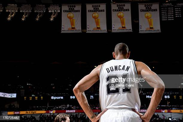 Tim Duncan of the San Antonio Spurs stands under the team's four Championship banners while playing the Miami Heat during Game Five of the 2013 NBA...