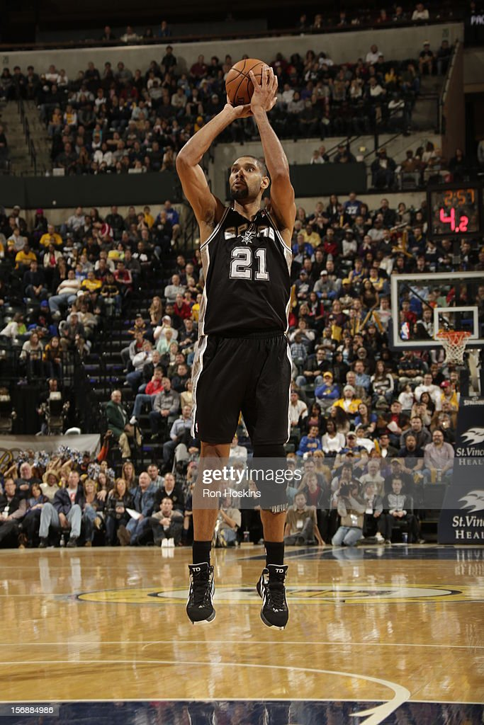 Tim Duncan #21 of the San Antonio Spurs takes a shot vs the Indiana Pacers on November 23, 2012 at Bankers Life Fieldhouse in Indianapolis, Indiana.