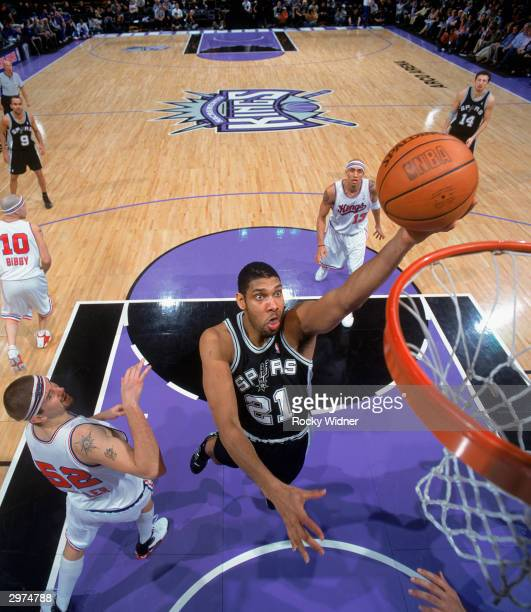 Tim Duncan of the San Antonio Spurs takes the ball up against the Sacramento Kings during the NBA game at Arco Arena on February 6 2004 in Sacramento...