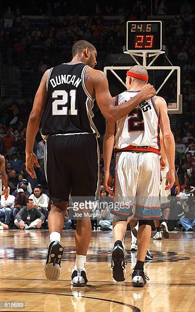 Tim Duncan of the San Antonio Spurs talks to Jason WIlliams of the Memphis Grizzlies at the end of the fourth quarter during a San Antonio victory at...