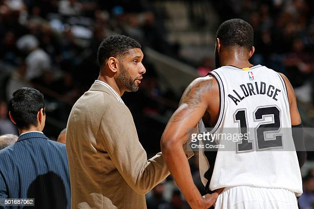 Tim Duncan of the San Antonio Spurs talks to LaMarcus Aldridge during the game against the Washington Wizards on December 16 2015 at the ATT Center...