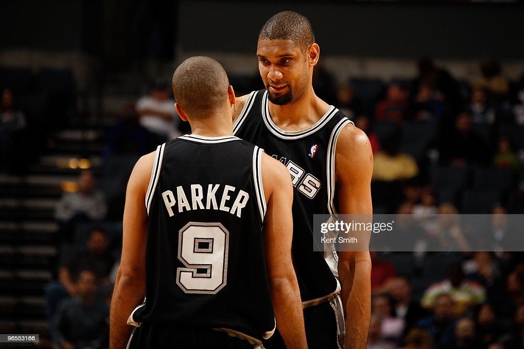 Tim Duncan #21 (R) of the San Antonio Spurs talks to teammate Tony Parker #9 (L) during the game against the Charlotte Bobcats on January 15, 2010 at Time Warner Cable Arena in Charlotte, North Carolina. The Bobcats won 92-76.
