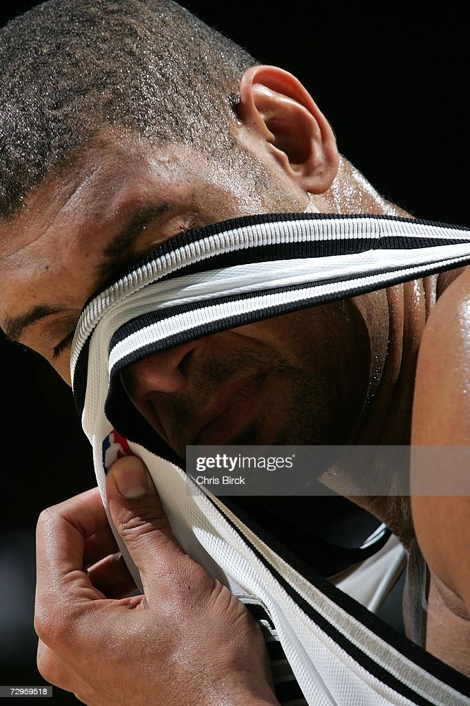 Tim Duncan #21 of the San Antonio Spurs wipes off the sweat while playing against the Portland Trail Blazers on January 9, 2007 at the AT&T Center in San Antonio, Texas.