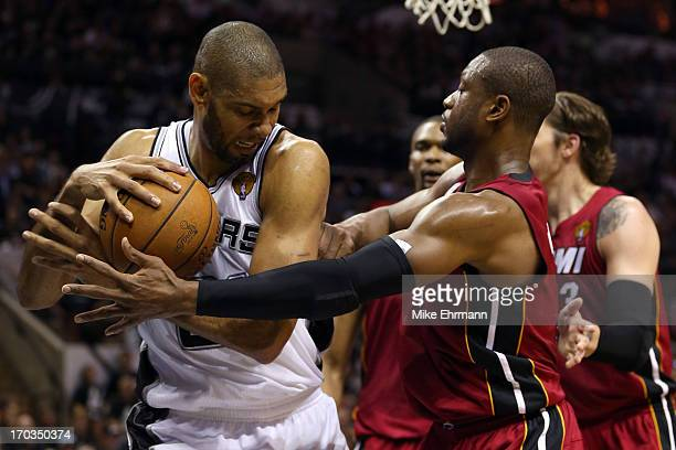 Tim Duncan of the San Antonio Spurs with the ball against Dwyane Wade of the Miami Heat in the second quarter during Game Three of the 2013 NBA...
