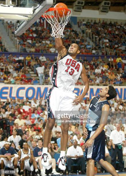 OUT*** Tim Duncan of the USA dunks past Leanardo Palladino of Argentina during the gold Medal game of the Athens Olympic Qualifying Basketball...