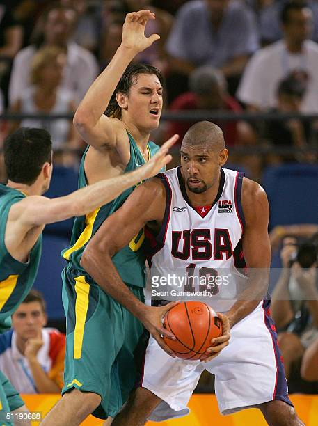Tim Duncan of the USA looks to make a play against Andrew Bogut of Australia during the men's basketball preliminary game on August 19, 2004 during...