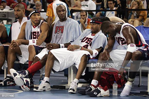 Tim Duncan of the USA sits on the bench with Lamar Odom Allen Iverson and Dwyane Wade during the Athens 2004 Summer Olympic Games against Angola at...