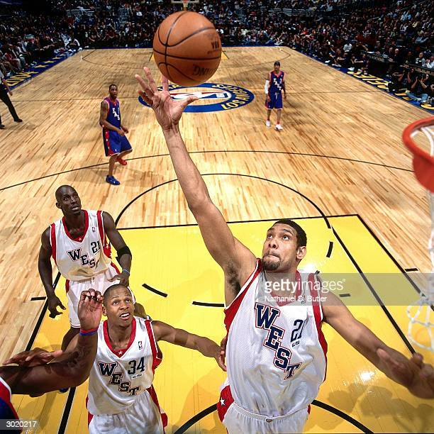 Tim Duncan of the Western Conference AllStars rebounds against the Eastern Conference AllStars during the 2004 AllStar Game on February 15 2004 at...