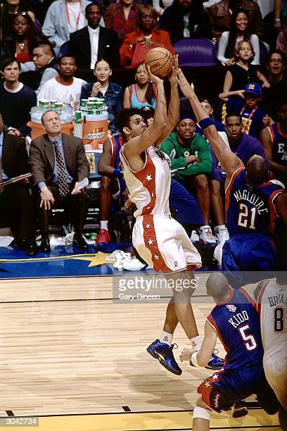 Tim Duncan of the Western Conference AllStars shoots the jump shot over Jamaal Magloire of the Eastern Conference AllStars during the 2004 AllStar...