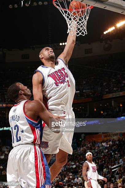 Tim Duncan of the Western Conference goes up for a shot on Dwight Howard of the Eastern Conference during the 2008 NBA AllStar Game part of 2008 NBA...