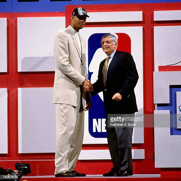 Tim Duncan taken number one overall by the San Antonio Spurs shakes NBA Commissioner David Stern's hand during the 1997 NBA Draft on June 25 1997 at...