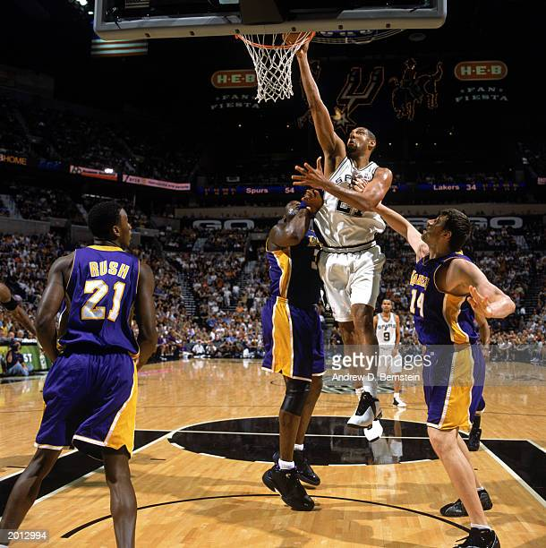 Tim Duncan the San Antonio Spurs takes the layup against Shaquille O'Neal and Stanislav Medvedenko of the Los Angeles Lakers in Game Five of the...