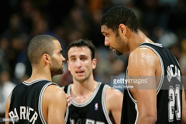 Tim Duncan Tony Parker 39 and Manu Ginobili of the San Antonio Spurs talk during the game with the Golden State Warriors on January 02 2006 at the...