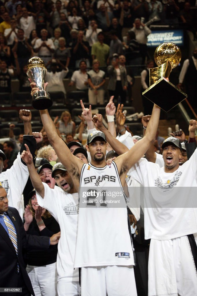 Tim Duncan #21, Tony Parker #9 and and Bruce Bowen #12 of the 2005 NBA Champion San Antonio Spurs celebrate winning Game seven of the 2005 NBA Finals against the Detroit Pistons 81-74 on June 23, 2005 at SBC Center in San Antonio, Texas.