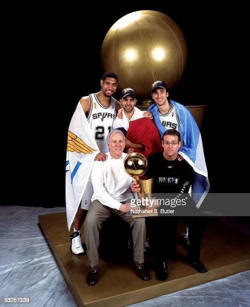 Tim Duncan Tony Parker Manu Ginobili head coach Gregg Popovich and general manager RC Buford of the San Antonio Spurs pose with their championship...