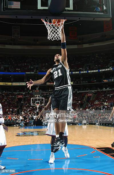 Tim Duncan#21 of the San Antonio Spurs goes for a layup during the game against the Philadelphia 76ers at Wachovia Center on November 14 2003 in...