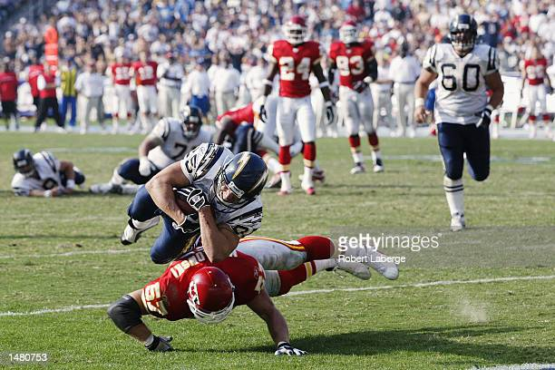Tim Dwight of the San Diego Chargers scores a touchdown in the fourth quarter as Mike Maslowski of the Kansas City Chiefs fails to block him during...