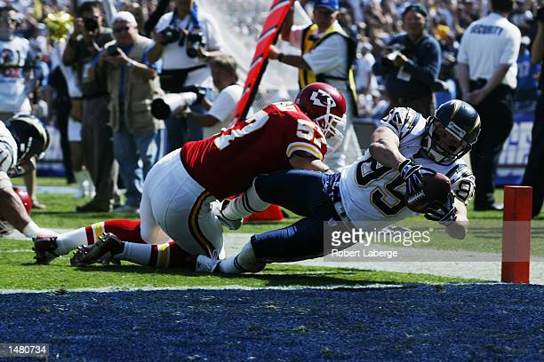 Tim Dwight of the San Diego Chargers scores the first touchdown of the game as Mike Maslowski of the Kansas City Chiefs tries to stop him during the...