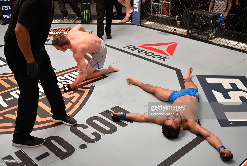 Tim Elliot rolls off Hiromasa Ogikubo after their bout during the filming of The Ultimate Fighter: Team Benavidez vs Team Cejudo at the UFC TUF Gym on August 10, 2016 in Las Vegas, Nevada.