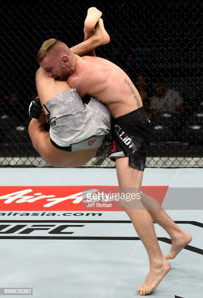Tim Elliott defends and arm bar submission attempt against Mark De La Rosa in their bantamweight bout during the UFC 219 event inside TMobile Arena...
