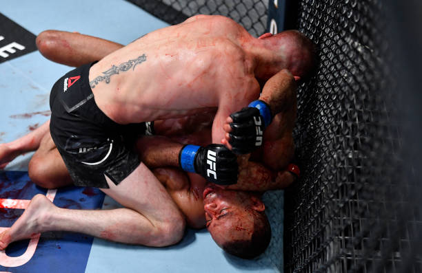 Tim Elliott elbows Jordan Espinosa in their flyweight fight during the UFC 259 event at UFC APEX on March 06, 2021 in Las Vegas, Nevada.